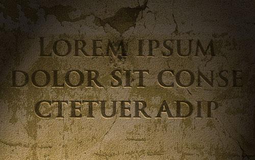পাথরের দেওয়ালের উপর পাথর খচিত লেখা